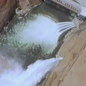 Spillways release whitewater into the Colorado River downstream of Glen Canyon Dam in 1983.