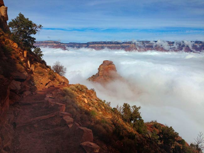 A view from above O'Neill Butte, looking down toward it from the South Kaibab Trail during an inversion event