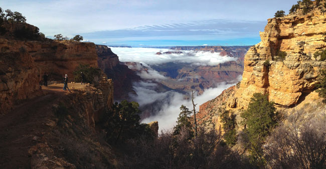 The skies below the canyon rim clear, revealing what lies beneath