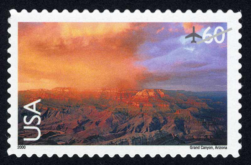 Sixty-cent airmail stamp with mirror image of Grand Canyon