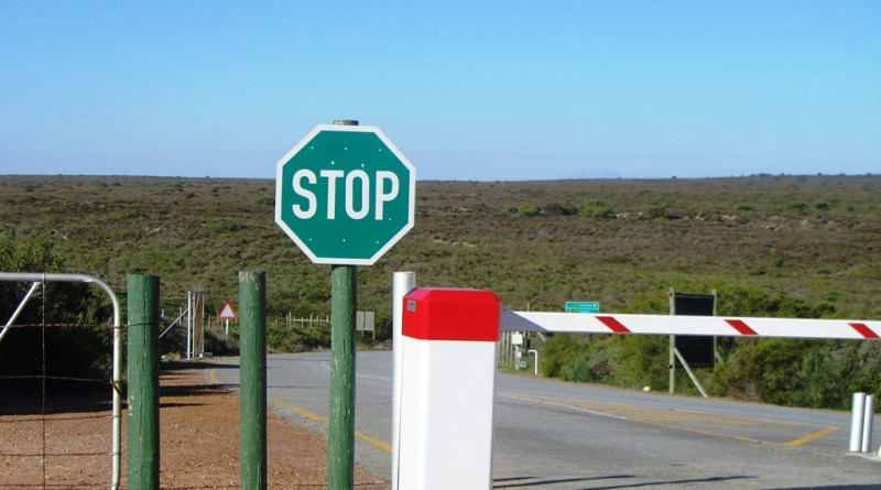 Stop sign at gate, West Coast National Park