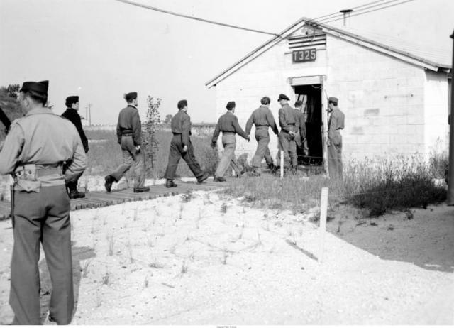 German POWs march into a barracks