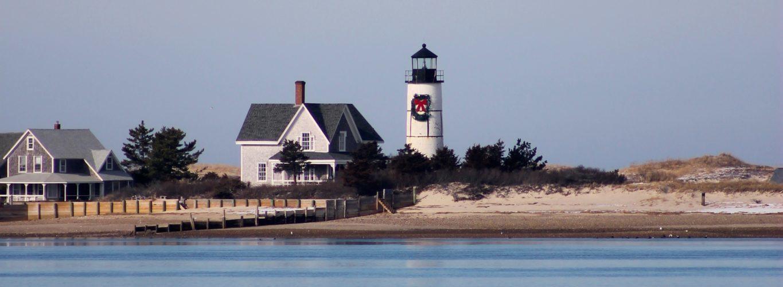 light house and a house on the beach