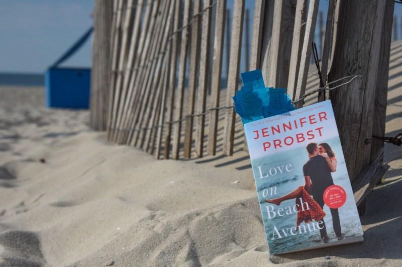 Photograph of the novel Love on Beach Avenue taken on the sand