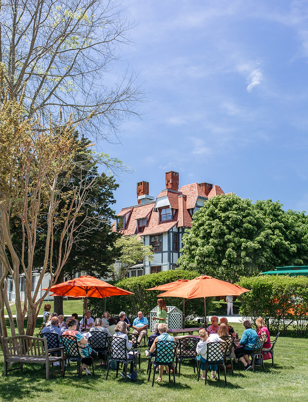 People dining outside of the Emlen Physick Estate