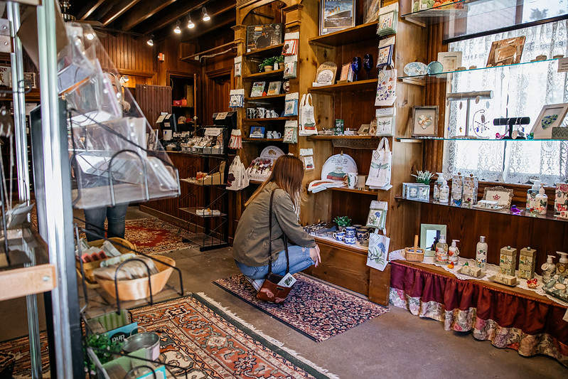 Woman shopping at the Carriage House gift shop