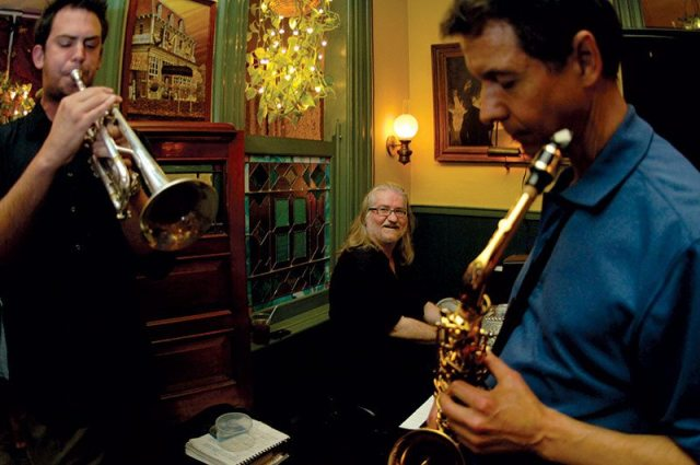 John Barnes on trumpet, Dr. Bob Rolands on alto saxophone, and George Mesterhazy seated at the piano. Photograph taken in June 2007 by Sharon Stabley and appeared in the August 2007 issue.