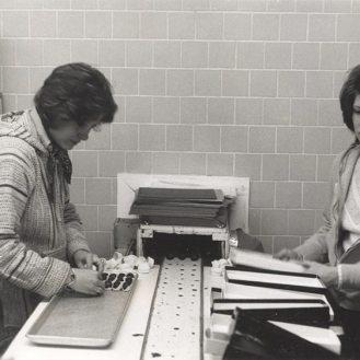 Cheryl Jackman (left) and Linda Wise at the conveyor belt