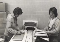 Cheryl Jackman (left) and Linda Wise at the conveyor belt