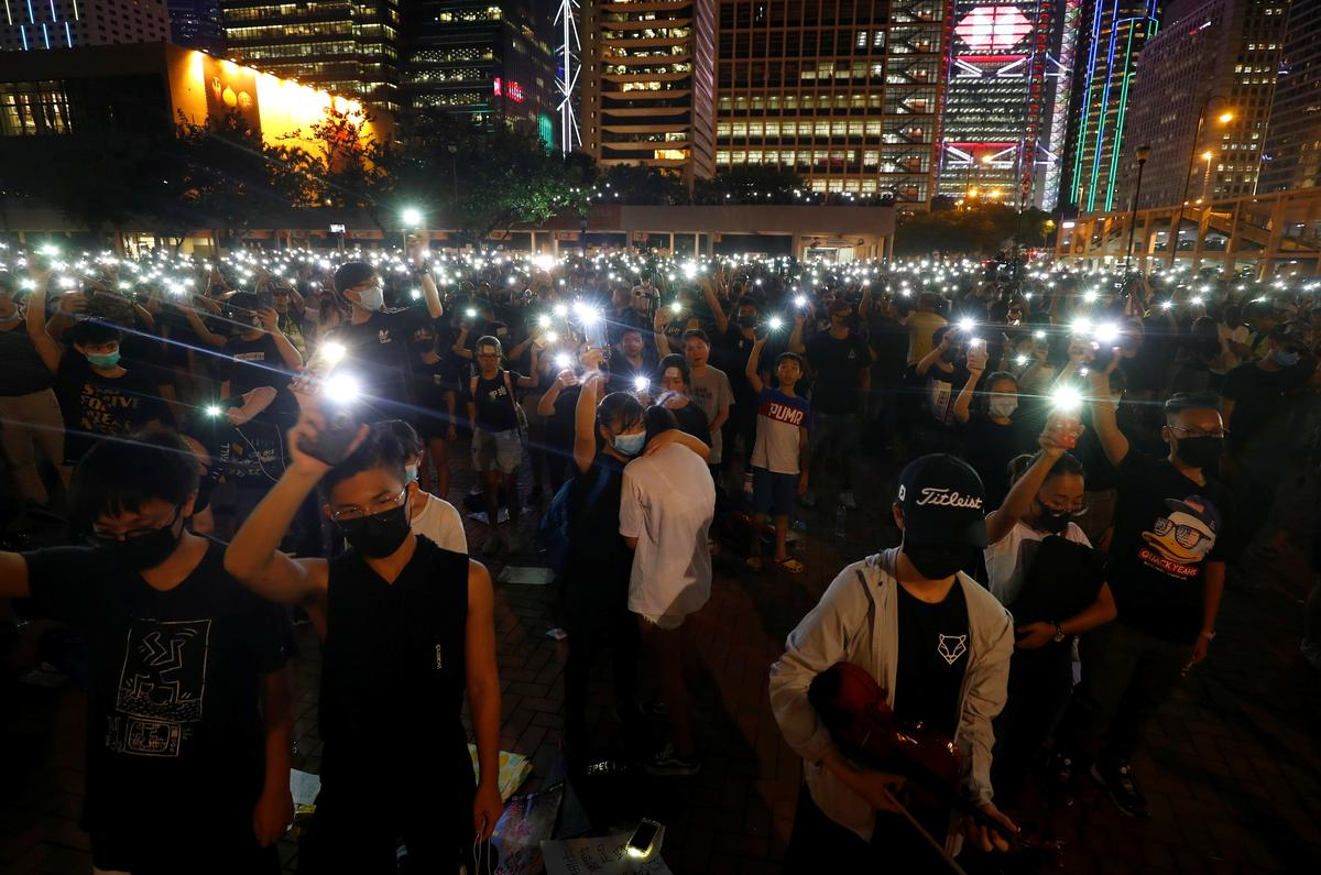 Hong Kong protesters target airport week after arrivals hall mayhem