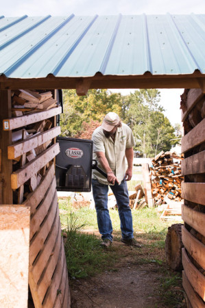 Pallets become fuel for Sundance Power Systems' heating systems through an outdoor wood boiler