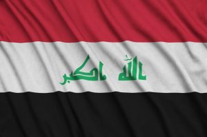 Iraq flag is depicted on a sports cloth fabric with many folds.