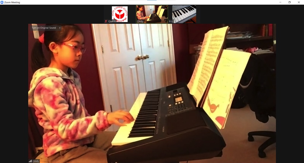 A person playing a piano Description automatically generated with medium confidence