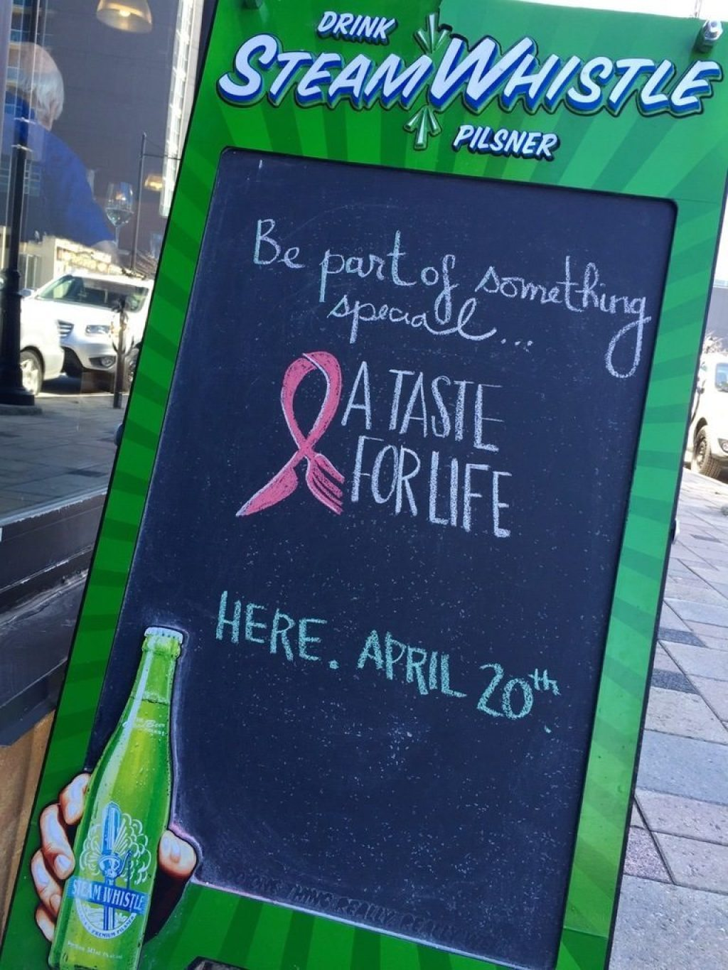 Sidewalk sign outside absinthe café