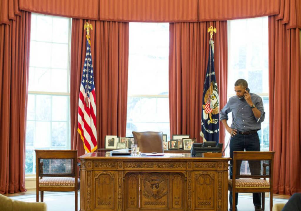 President Barack Obama talks on the phone in the Oval Office with Russian President Vladimir Putin about the situation in Ukraine, March 1, 2014. (Official White House Photo by Pete Souza)