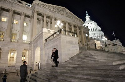 Congressmen walk down the steps of the House of Representatives as they work overnight on a spending bill, on Capitol Hill in Washington, Friday, Feb. 18, 2011. (AP Photo/J. Scott Applewhite)