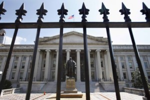A statue of former Treasury Secretary Albert Gallatin stands guard outside the Treasury Building in Washington, Monday, Aug. 8, 2011, as stocks slid Monday amid a rout in global stocks after Standard & Poor's downgraded the U.S. credit rating. (AP Photo/Jacquelyn Martin)