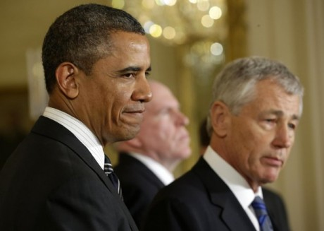President Barack Obama listens in the East Room of the White House in Washington, Monday, Jan. 7, 2013, where he announced that he is nominating Deputy National Security Adviser for Homeland Security and Counterterrorism, John Brennan, center, as the new CIA director; and former Nebraska Sen. Chuck Hagel, right, as the new defense secretary.(AP Photo/Pablo Martinez Monsivais)