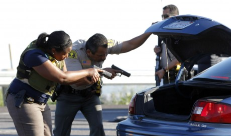Police search at roadblock (AP Photo)
