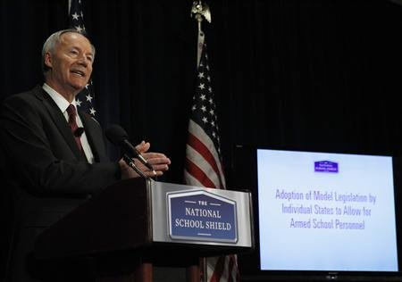 Former Rep. Asa Hutchinson (R-AR), a consultant of the National Rifle Association, discusses the findings and recommendations of the National School Shield Program at the National Press Club in Washington April 2, 2013. (REUTERS/Gary Cameron)
