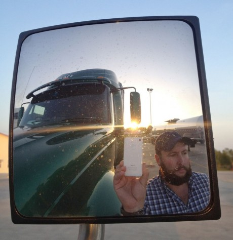 """James Weitze takes a self portrait on the road. Weitze satisfies his video fix with an iPhone. He sleeps most of the time in his truck, and has no apartment. To be sure, he's an extreme case and probably wouldn't fit into Nielsen's definition of a household in the first place. But he's watching Netflix enough to keep up on shows like """"Weeds,"""" """"30 Rock,"""" """"Arrested Development,"""" """"Breaking Bad,"""" """"It's Always Sunny in Philadelphia"""" and """"Sons of Anarchy."""" (AP Photo/James Weitze)"""