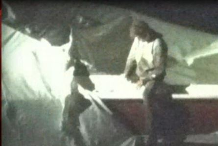 Surveillance photo of Boston bombing suspect Dzhokhar Tsarnaev on the boat that he was attempting to hide in as police cornered and arrested him.