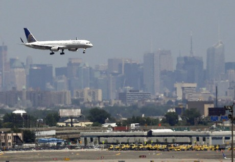 United plane prepares to land at Newark Liberty International Airport in Newark, N.J., with the New York City skyline in the background. Commercial airline flights moved smoothly throughout most of the country on Sunday, April 21, 2013, the first day air traffic controllers were subject to furloughs resulting from government spending cuts, though some delays appeared in the late evening in and around New York. The real test, however, will come Monday, when traffic ramps up. (AP Photo/Julio Cortez, File)
