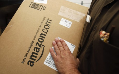 Amazon.com package is prepared for shipment by a United Parcel Service (UPS) driver in Palo Alto, Calif. States could force Internet retailers to collect sales taxes under a bill that overwhelmingly passed a test vote in the Senate. (AP Photo/Paul Sakuma, File)