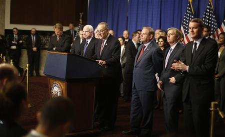 """The U.S. Senate's """"Gang on Eight"""" are pictured during a news briefing on Capitol Hill. (REUTERS/Jason Reed)"""