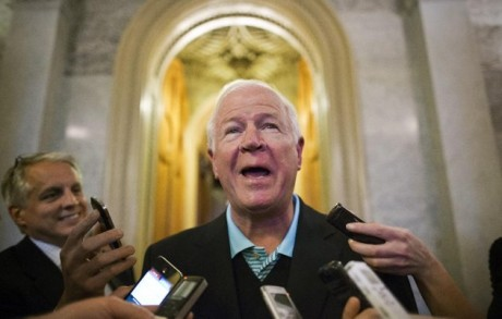 Sen. Saxby Chambliss, R-Ga., smiles as he talks to reporters about making a hole-in-one during a golf outing earlier in the day with President Barack Obama and a bipartisan trio of senators, on Capitol Hill in Washington, Monday, May 6, 2013. The Senate was just voting on legislation to collect sales tax on Internet purchases. (AP Photo/J. Scott Applewhite)