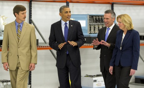 President Barack Obama tours Applied Materials Inc., with Rick Gesing, left, Mike Splinter, center, and Mary Humiston, right, during a visit to the facilities in Austin, Texas. (AP Photo/Austin American-Statesman, Rodolfo Gonzalez, Pool)