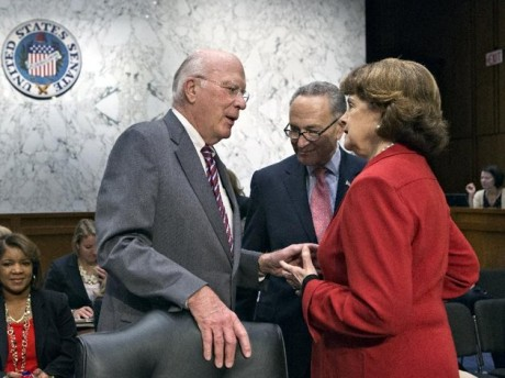 Senate Judiciary Committee Chairman Patrick Leahy, D-Vt., left, confers with Sen. Chuck Schumer, D-N.Y., center, and Sen. Dianne Feinstein, D-Calif., as the Senate Judiciary Committee assembled to work on a landmark immigration bill to secure the border and offer citizenship to millions, on Capitol Hill in Washington. Leading senators working on immigration legislation reached a compromise Tuesday on the details of an expanded high-tech visa program, officials said as the Senate Judiciary Committee neared completion of its work on the measure. At the same time, several officials said the White House has made it known to Leahy that it would prefer postponing a showdown over the rights of same sex spouses until a vote in the full Senate. (AP Photo/J. Scott Applewhite, File)