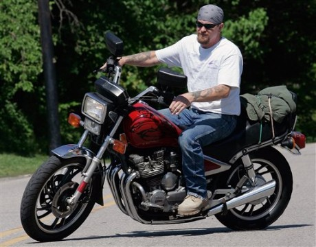 Randy Knauff takes off from work without a helmet on his motorcycle in Harmony, Pa. (AP Photo/Keith Srakocic, File)