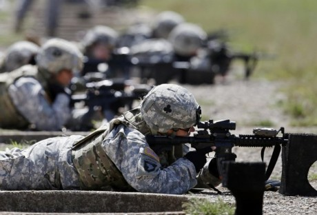 female soldiers from 1st Brigade Combat Team, 101st Airborne Division train on a firing range while testing new body armor in Fort Campbell, Ky., in preparation for their deployment to Afghanistan. Women may be able to begin training as Army Rangers by mid-2015, and as Navy SEALs a year later under broad plans Defense Secretary Chuck Hagel is approving that would slowly bring women into thousands of combat jobs, including those in the country's elite special operations forces, according to details of the plans submitted to Hagel that were obtained by The Associated Press. (AP Photo/Mark Humphrey, File)