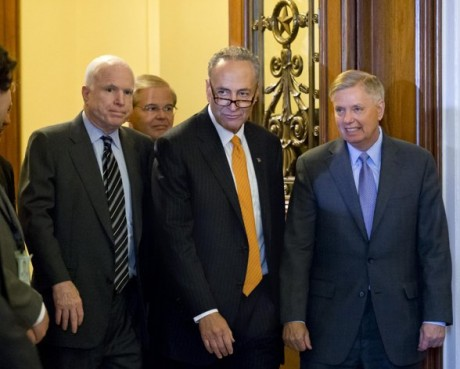 Senators John McCain, Chuck Schumer and Lindsey Graham after immigration bill clears Senate (AP/J.Scott Applewhite)