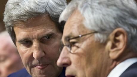 Secretary of State John Kerry, left, talks with Defense Secretary Chuck Hagel on Capitol Hill in Washington.  (AP Photo/J. Scott Applewhite)