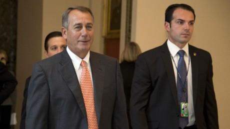 House Speaker John Boehner of Ohio walks vote on the House floor on Capitol Hill, Thursday. (AP Photo/Carolyn Kaster)