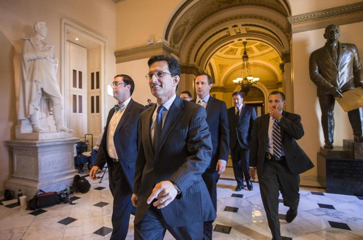 House Majority Leader Eric Cantor (R-VA) smiles as he leaves the House floor on Friday. (AP Photo/Scott Applewhite)