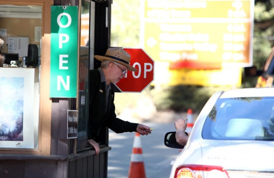 Yosemite Park Ranger Ron Morton takes payment for admittance after park reopened. (AP/Gary Kazanjian)
