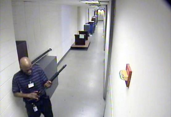 Aaron Alexis in hallway of Navy Yard during killing spree (FBI video image)