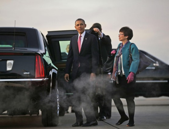 President Barack Obama looks at the view of Mount Rainier at sunset with White House senior adviser Valerie Jarrett, right, upon their arrival at Seattle-Tacoma International Airport. (AP Photo/Pablo Martinez Monsivais)