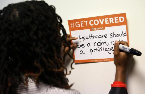 A woman fills out her thoughts on the Affordable Care Act at the White House Youth Summit on the Affordable Care Act in Washington. (REUTERS/Kevin Lamarque)