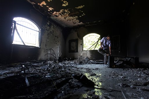 Libyan man investigating the inside of the  U.S. Consulate in Benghazi.  (AP Photo/Mohammad Hannon, File)