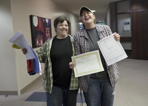 Elise Larsen and Samantha Christensen display their marriage license in Salt Lake County, Utah. (AP/Kim Raff)
