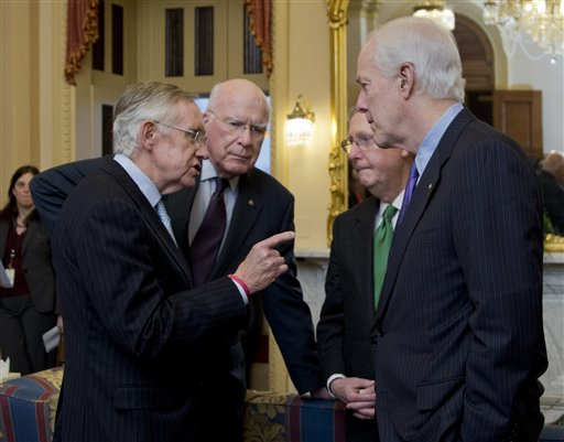 Senate Majority Leader Harry Reid, D-Nev., from left, Sen. Patrick Leahy, D-Vt., Republican Leader Mitch McConnell, R-Ky., and Sen. John Cornyn, R-Texas, talk as they wait in the majority leader's office, for a meting King Abdullah II of Jordan, on Capitol Hill in Washington, Wednesday.   (AP Photo/Manuel Balce Ceneta)