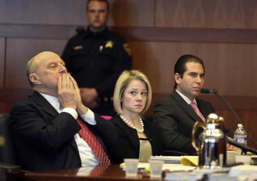 New Jersey Gov. Chris Christie's former Deputy Chief of Staff Bridget Anne Kelly, center, sits with her attorney Michael Critchley, left.  (AP Photo/The Record of Bergen County, Chris Pedota, Pool)