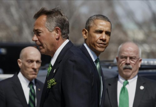 President Barack Obama and House Speaker John Boehner of Ohio part ways following a St. Patrick's Day luncheon on Capitol Hill in Washington, Friday. (AP Photo/J. Scott Applewhite)