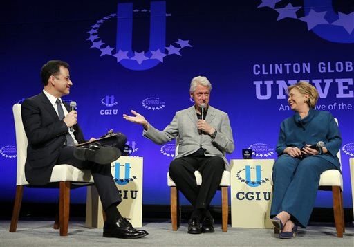 Former President Bill Clinton, center, and former Secretary of State Hillary Rodham Clinton, right, speak with talk show host Jimmy Kimmel during a student conference for the Clinton Global Initiative University   (AP Photo/Matt York)