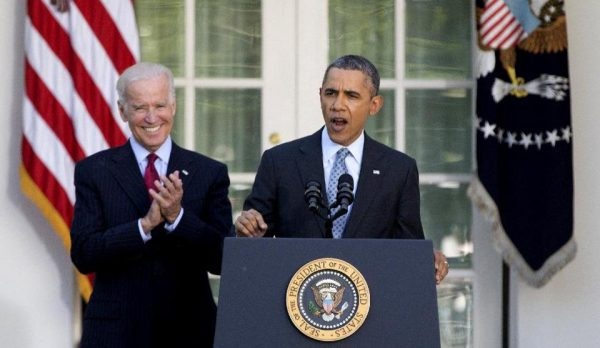 President Barack Obama, with Vice President Joe Biden, speaks in the Rose Garden of the White House in Washington, Tuesday.  (AP Photo/Carolyn Kaster)