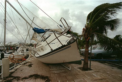 A sailboat sits on a sidewalk at Dinner Key in Miami after it was washed ashore by Hurricane Andrew.  (AP Photo/Terry Renna)
